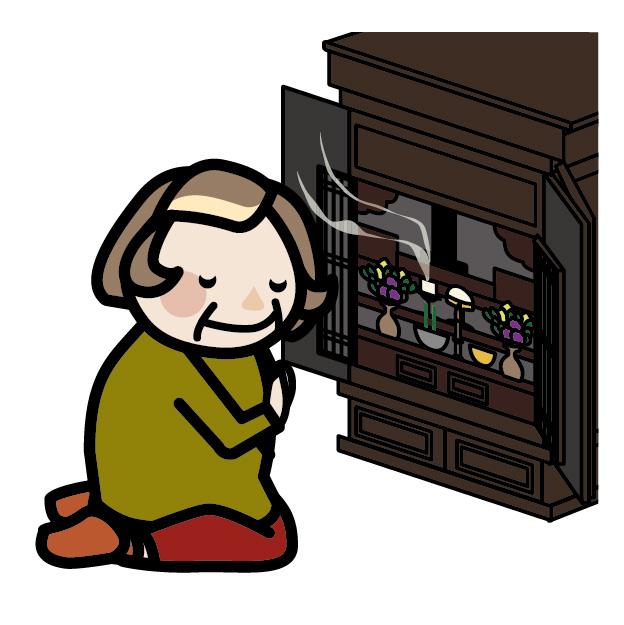 仏壇にお参りするおばあさん